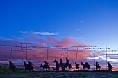 Iron sculpture of a group of pilgrims, Alto del Perdon, Sierra del Perdon, near Pamplona, Camino Frances, Way of St. James, Camino de Santiago, pilgrims way, UNESCO World Heritage, European Cultural Route, province of Navarra, Northern Spain, Spain, Europ