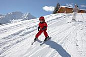Mother and daughter skiing, Schlosslelift, Kleinwalsertal, Vorarlberg, Austria