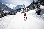 Child schuss skiing, ski area Heuberg, Kleinwalsertal, Vorarlberg, Austria