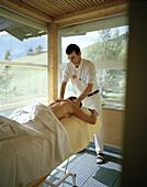 Woman having a relaxing massage, Wellness treatment, organic Hotel Chesa Valisa, Hirschegg, Kleinwalsertal, Austria