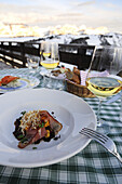 A table is laid on a balcony in front of Sella group, Hotel Col Alt, Alta Badia, South Tyrol, Italy, Europe