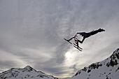 Ski bob artist during jump, Stubai glacier, Stubai Alps, Tyrol, Austria, Europe