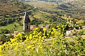 Sunlit church at mountain village, Rocca Calascio, Gran Sasso National Park, Abruzzi, Italy, Europe