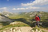 Hiker at Carno Grande, Campo Imperatore, Gran Sasso National Park, Abruzzi, Italy, Europe