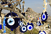 Protection amulets against evil eye in front of the mountain city Uchisar, Göreme, Cappadocia, Turkey