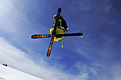Low angle view at skier during jump, Reit im Winkl, Chiemgau, Upper Bavaria, Bavaria, Germany, Europe