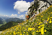 Couple with climbing equipment in the mountains, Gamssteig fixed rope route, Steinplatte, Reit im Winkl, Chiemgau, Upper Bavaria, Bavaria, Germany, Europe