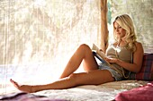 Adult, Adults, Barefeet, Barefoot, Blonde, Blondes, Book, Books, Calm, Calmness, Caucasian, Caucasians, Color, Color image, Colour, Contemporary, Daytime, Fair-haired, Female, Full body, Full length, Full-body, Full-length, Hobbies, Hobby, holiday, holida