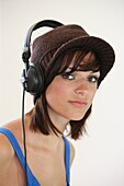 adolescence, adolescent, adolescents, Brown eyes, Brunette, Brunettes, Caucasian, Caucasians, Clipping path, Color, Color image, Colour, Contemporary, Dark-haired, Earphone, Earphones, Facing camera, Female, Girl, Girls, Hat, Hats, Head & shoulders, Head