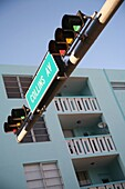 Avenue, Avenues, Building, Buildings, cities, city, Collins Avenue, Color, Color image, Colour, Daytime, exterior, From below, Green, Information, Low angle, Low angle view, outdoor, outdoors, outside, Sign, Signs, Stop light, Street, Streets, Traffic, Tr