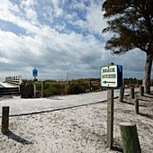 Sign pointing to beach access in Florida