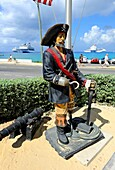 Pirate statue with flags at Tortuga Rum Cake Ship Grand Cayman Islands Caribbean Georgetown