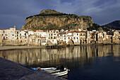 Old port Mt. La Rocca fishing boats vessels beach Moorish architecture Town of Cefalu Palermo Province Sicily Italy