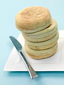 English muffins isolated against a blue background