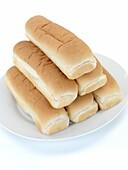 Plain hotdog buns isolated against a white background