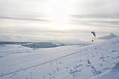 Snow kiting at Wasserkuppe mountain near Gersfeld,  low mountain range, Rhoen, Hesse, Germany