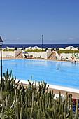 open-air swimming pool with cactus near the sea, Los Silos near Buenavista del Norte, Northwest Tenerife, Spain