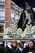 Women With An Air Of Sorrow And Reverence Carrying The Statue Of Virgin Mary On A Shield Decorated With Flowers, Procession Of The Brotherhood Of Silence (Confradia Del Silencio) Of The Parish Of The Holy Christ Of Faith Church, Madrid, Spain