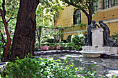 Statue Of Women In Front Of The Fountain In The Gardens Of The Museum Home Of The Painter Joaquin Sorolla, Madrid, Spain