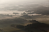 Aerial of a North German landscape in the morning mist, near Lueneburg and Uelzen, Lower Saxony, Germany