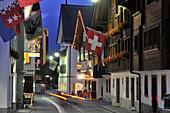Houses with flags,  Andermatt, Uri, Switzerland