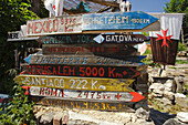 Wooden signpost in the sunlight, Manjarin, Province of Leon, Old Castile, Castile-Leon, Castilla y Leon, Northern Spain, Spain, Europe
