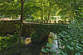 Old mill, brook and bridge near monastery of Samos, railing in scallop shape, Province of Lugo, Galicia, Northern Spain, Spain, Europe