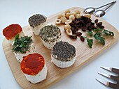 Goat cheese with red pepper, herbs, nuts and raisins