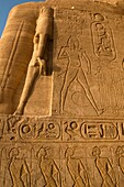 bas relief carvings on the walls of the Sun Temple at Abu Simbel in Egypt in morning sunlight
