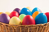 A basket full of colorful easter eggs