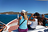 Tourists on a ship when windy, Island of Spinalonga, Lasithi prefecture, Gulf of Mirabella, Crete, Greece