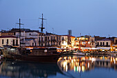 Old venetian port with clipper ship in the evening, Rethymnon, Crete, Greece