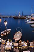 Restaurant, old venetian port in the evening, Rethymnon, Crete, Greece
