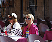Young women in a  cafe at harbor, Chania, Chania Prefecture, Crete, Greece