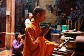 Monk praying, Phuoc Hai Tu, Ho Chi Minh City, Vietnam