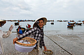 Fisherman carrying basekt, Mui Ne, Binh Thuan, Vietnam