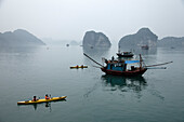 Kayak and fishing boat, Halong Bay, Quang Ninh, Vietnam