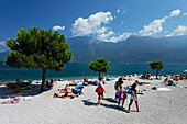 People on the beach, nearby Limone, Lake Garda, Lombardy, Italy
