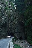 Car, narrow road, Canyon nearby Treve, Lake Garda, Lombardy, Italy