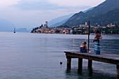 Women, Boardwalk, Evening mood, Malcesine, Lake Garda, Veneto, Italy