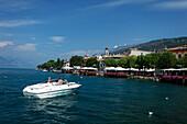 Couple, boat, Torri del Benaco, Lake Garda, Veneto, Italy