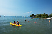 People swimming, Lazise, Lake Garda, Veneto, Italy