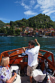 Man pointing, excursion boat, Bellagio, Lake Como, Lombardy, Italy