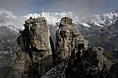Man cheering a rock, after passig a highline, Schilthorn, Bernese Oberland, Canton of Bern, Switzerland