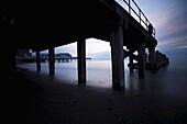 Aberystwyth pier, promenade and seashore at dusk, long exposure image, Wales UK