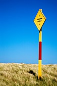 Colourful Power Cable Sign Lindisfarne Northumberland England