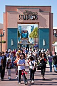 Orlando, FL - Feb 2009 - Park visitors walk under Disney's Hollywood Studios sign above walkway at Hollywood Studios theme park in Kissimmee Orlando Florida