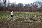 Prairieville, Michigan - A woman walks a labyrinth at Circle Pines camp The labyrinth is an aid to meditation the spiritualism © Jim West