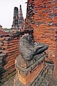 Headless Buddha figure in Wat Chai Wattanaram, ruined Buddhist temple in Ayutthaya, Thailand