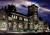 University College at night at University of Toronto Canada Artistic wintertime scenery with dramatic red blue sky